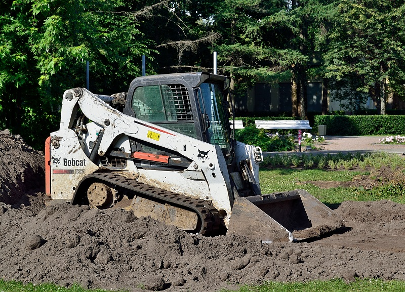 A Bobcat T650 compact track loader in the VDNKh, Moscow, Russia. A side view.
